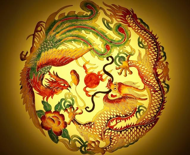 Dragon and phoenix stencil on yellow background