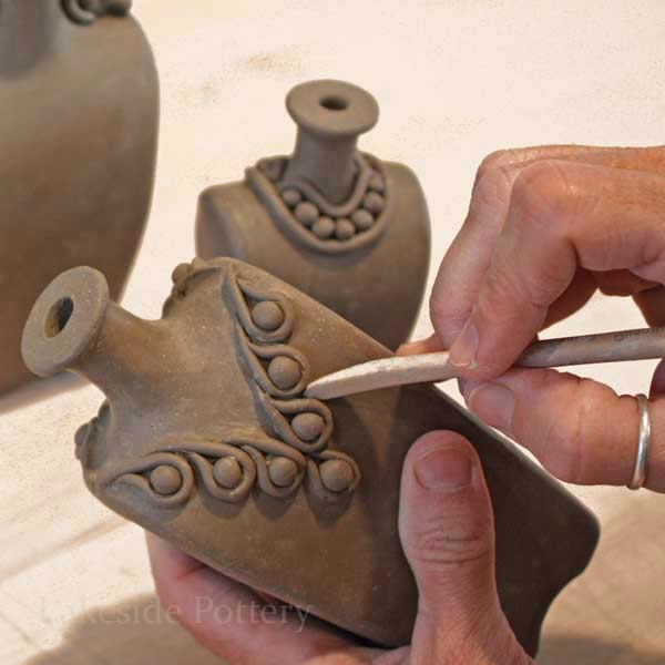 make clay pinch pots a simple art project for kids bored art
