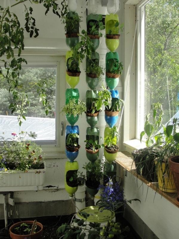 40 brilliant plastic bottle garden ideas for Garden design using plastic bottles
